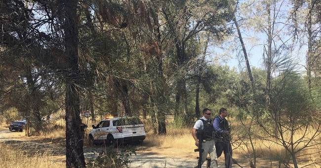 The Latest: Suspect in shooting of 2 deputies found dead