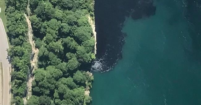 Discharge turns water at base of Niagara Falls black