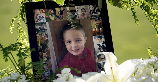 Dad admits killing son in court as mom sobs over boy's ashes