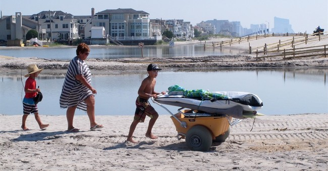 Soggy shore town OKs renewed court fight against dunes