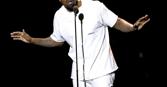 Kanye West's touring company sues over concert insurance