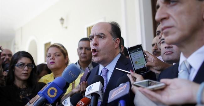 The Latest: Maduro says company's vote claim part of US plot