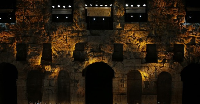 The Latest: Refugee children bring Acropolis alive with song