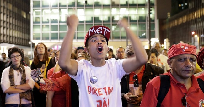 Weary from scandals, Brazilians shrug at probe of president