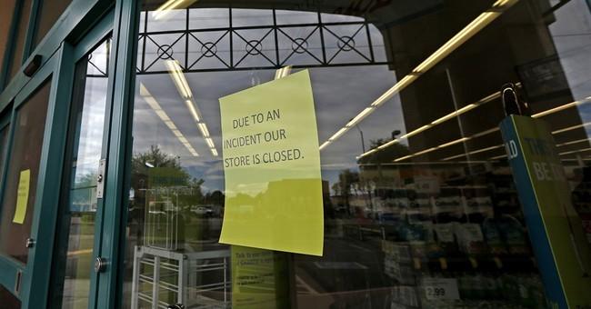 Pharmacy customer  shoots armed man demanding opioids