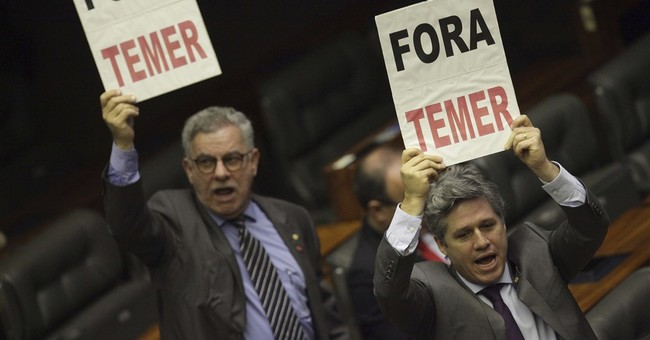 Brazil embattled president survives vote on bribery charge