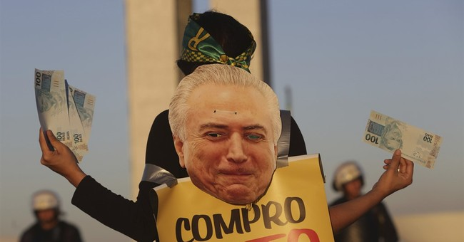 The Latest: Brazil's president survives congressional vote