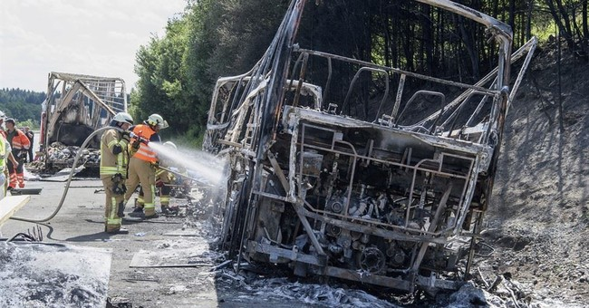 Bus driver's inattentiveness led to German crash, killing 18