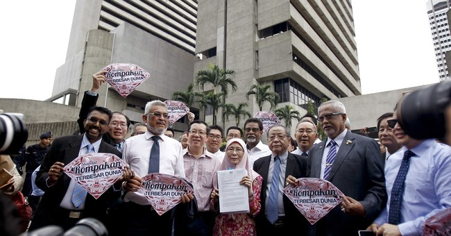 Malaysia central bank urged to reopen probe on indebted fund