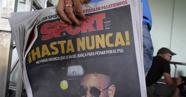 The Latest:  Neymar looking to take PSG to the top