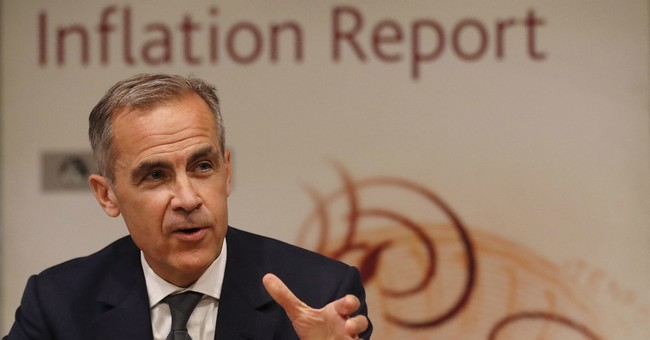 Bank of England cuts growth forecasts, keeps rates low