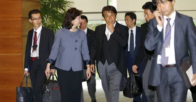 Japan's Cabinet gets makeover as support for Abe dips