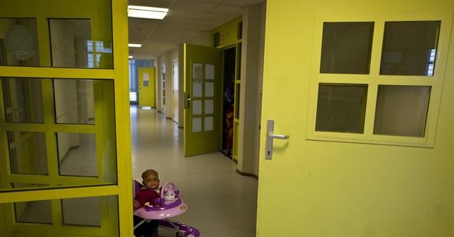 AP PHOTOS: Former Dutch prison helps asylum-seekers fit in