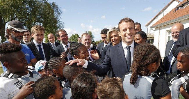 French president visits children at charity holiday program
