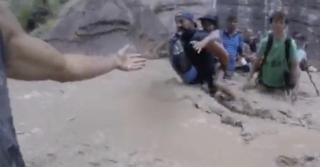 Hikers form human chain in flood-swollen Utah river