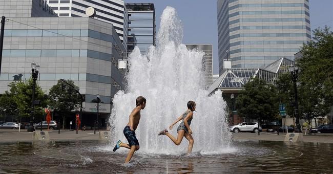 The Latest: Another hot day scorches Pacific Northwest