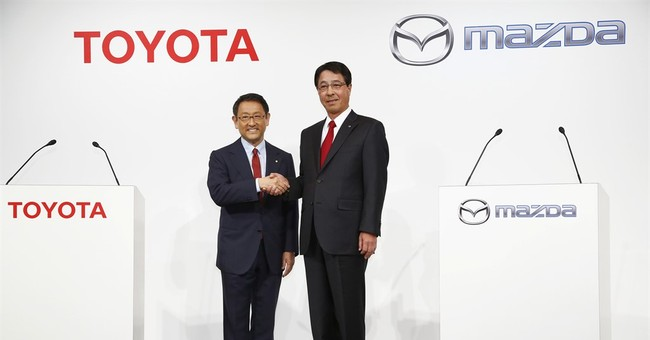 Toyota's quarterly profit improves on strong sales