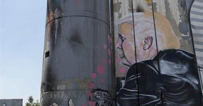 2 huge Trump murals appear on West Bank barrier