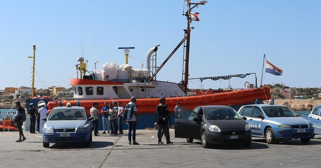 The Latest: Italy: Migrant mission off Libya going ahead