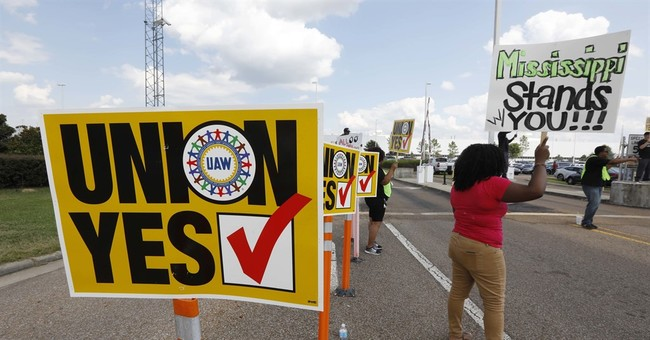 The Latest: Nissan says workers reject UAW in Mississippi