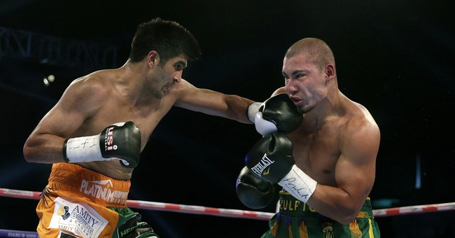 Indian boxer beats Chinese rival but doesn't want his belt
