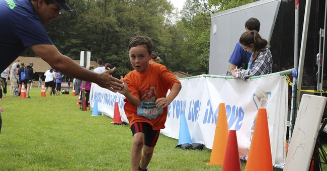 Kid athletes train in triathlon named for Sandy Hook victim