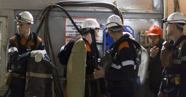 Russian miner rescued from flooded mine, 8 still missing