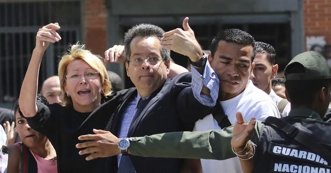 The Latest: Venezuela opposition leader back to house arrest