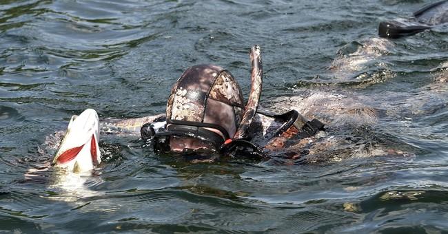 Russia's Putin shows off spoils from Siberia fishing trip
