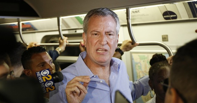 NYC mayor pushes for tax on the 1 percent to fund subway fix