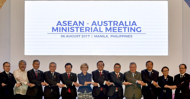 The Latest: ASEAN hits China's reclamations, militarization