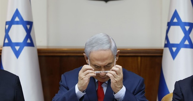 Israel's Netanyahu looks to exude calm in face of charges
