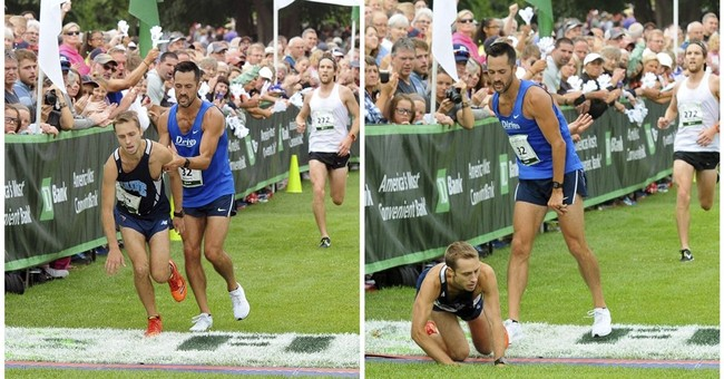 Struggling runner crosses finish line with competitor's help