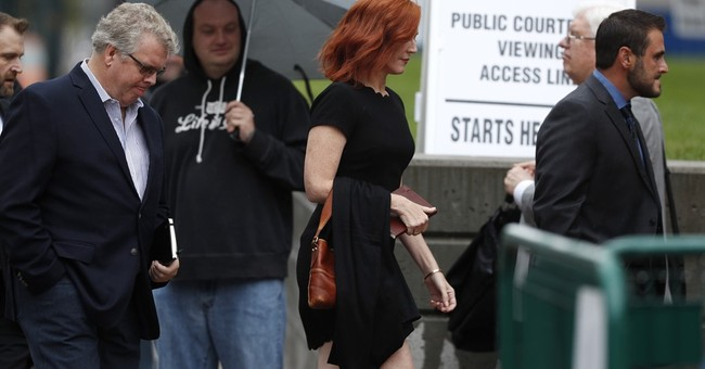 The Latest: Proceedings end for day in Swift groping case