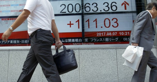 Global stocks mixed as boost from US jobs report fades