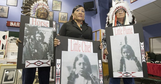 A century after deaths, Native American students return home