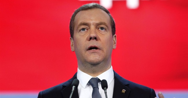 Russia PM calls idea US will lift sanctions soon 'illusion'
