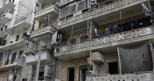 In midst of Aleppo wreckage, a Syrian family returns home