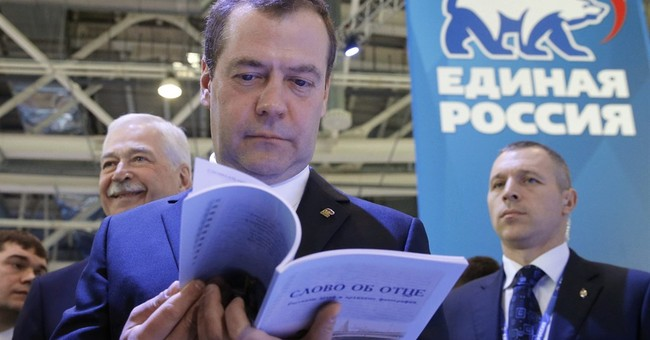 Russia PM calls idea US will lift sanctions soon 'illusion'