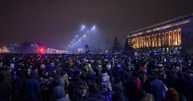Romanian president calls for referendum on prisoner pardons
