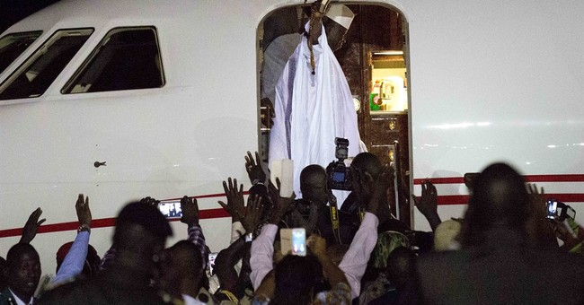Gambia's defeated leader leaves country, ends standoff