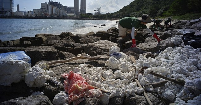 Palm oil blobs cover Hong Kong beaches after sea crash