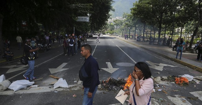 The Latest: Venezuelan court orders jail for another mayor