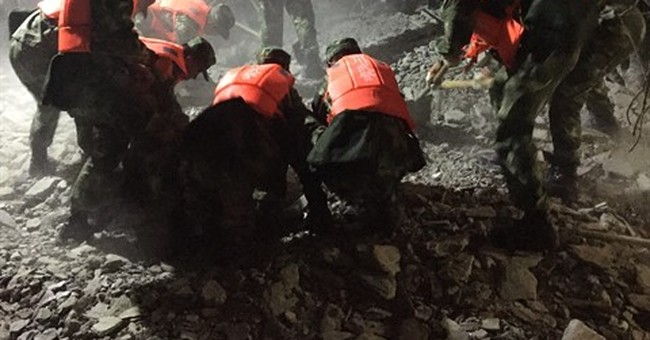 The Latest: Death toll in China's Sichuan quake rises to 13