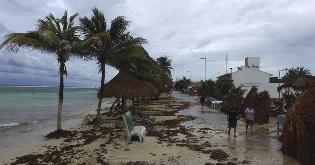 Weaker TS Franklin crosses Yucatan, aims for Mexico mainland