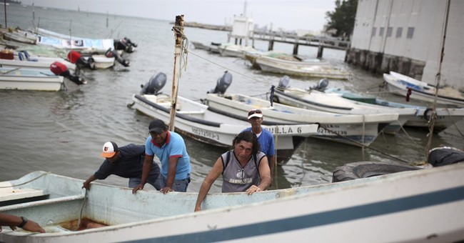 The Latest: Franklin weakens to tropical storm over Mexico