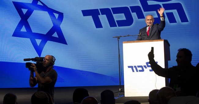 The Latest: Netanyahu delivers fiery speech at rally