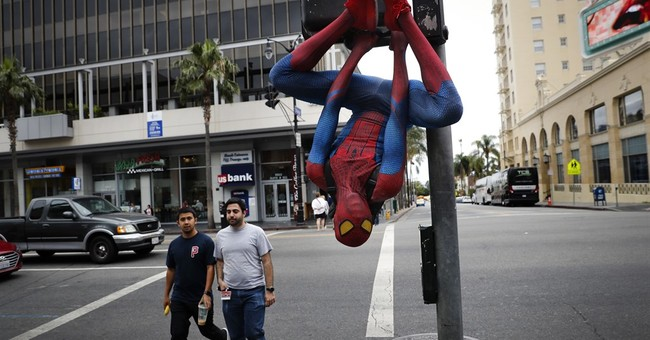 AP PHOTOS: Hollywood Boulevard street performers unmasked
