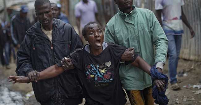 AP PHOTOS: Kenyans run for cover as day after vote erupts