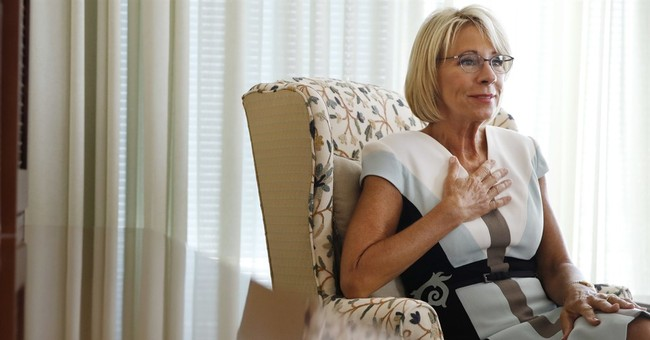 AP Interview: DeVos says she didn't decry racism enough